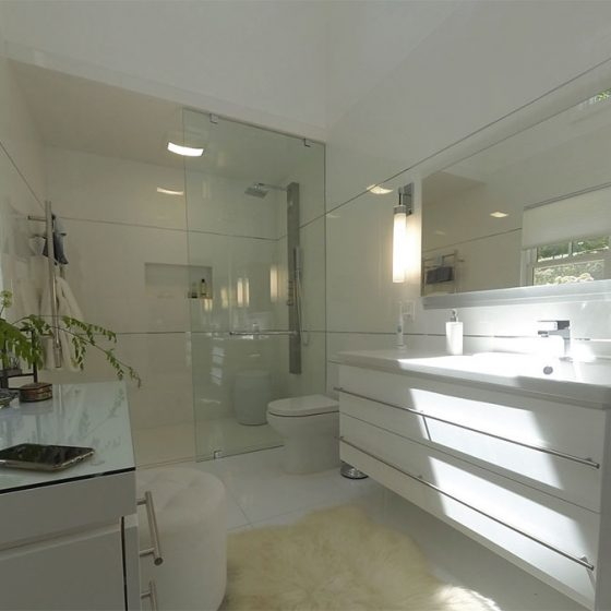 wide-angle view of bathroom and shower