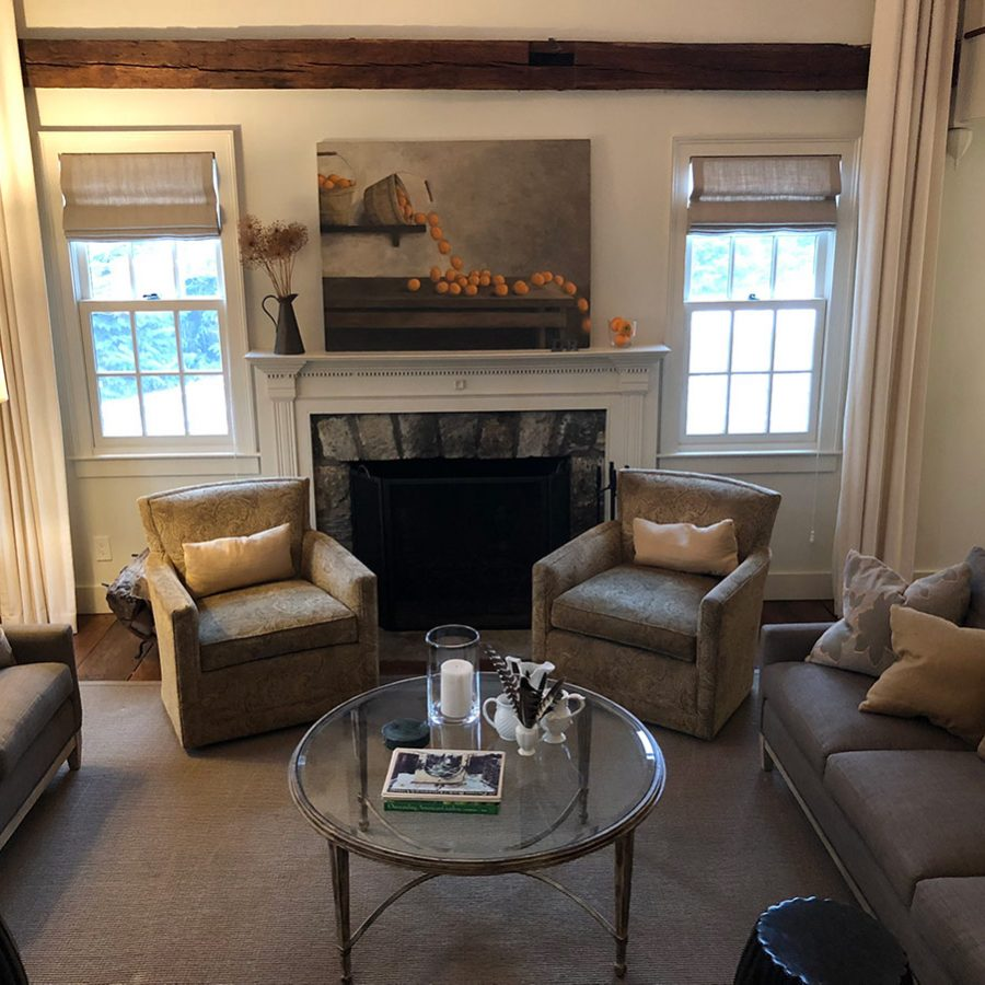 updated farmhouse living room with stone fireplace